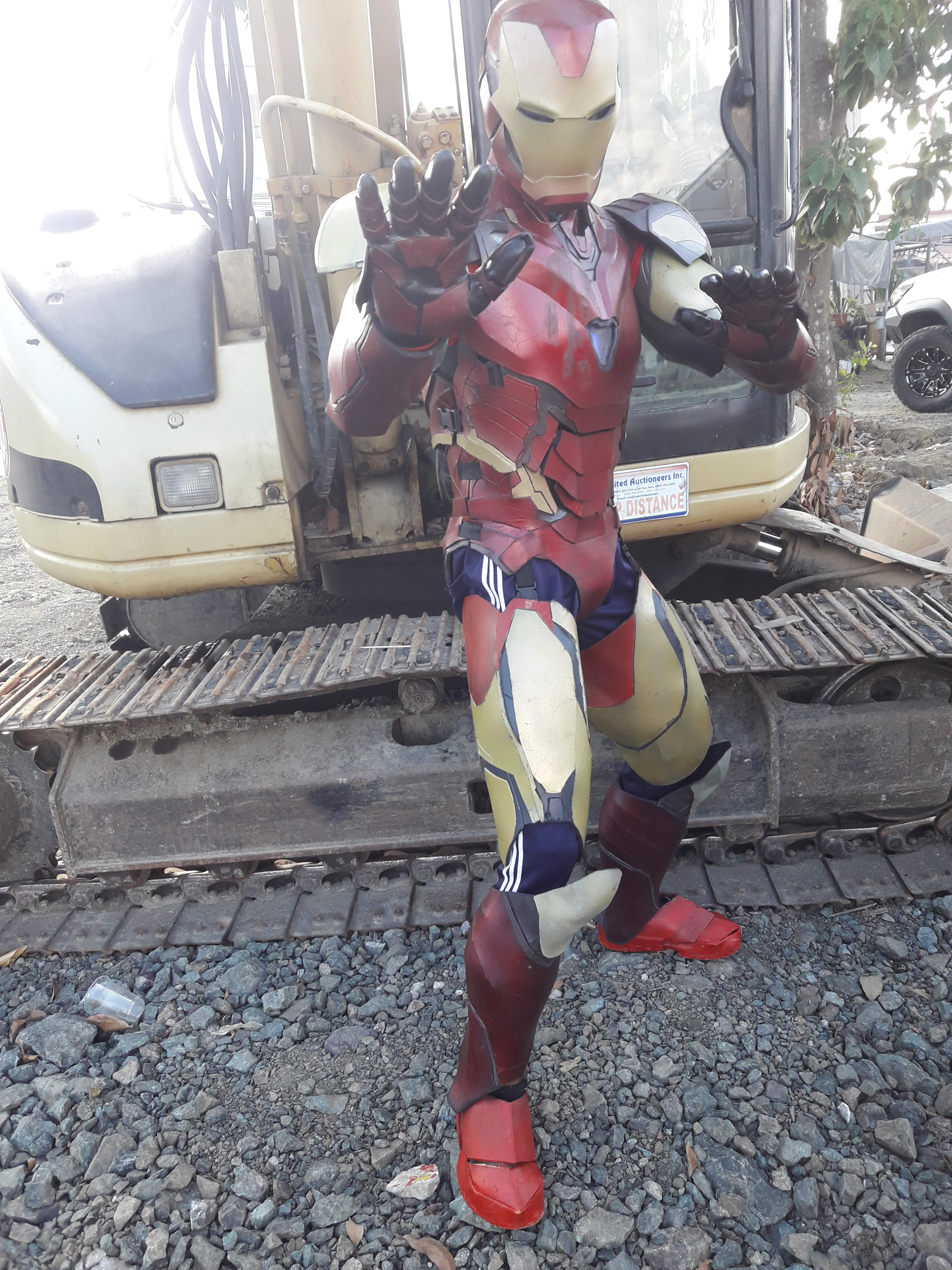 Man in red and yellow Iron Man armor