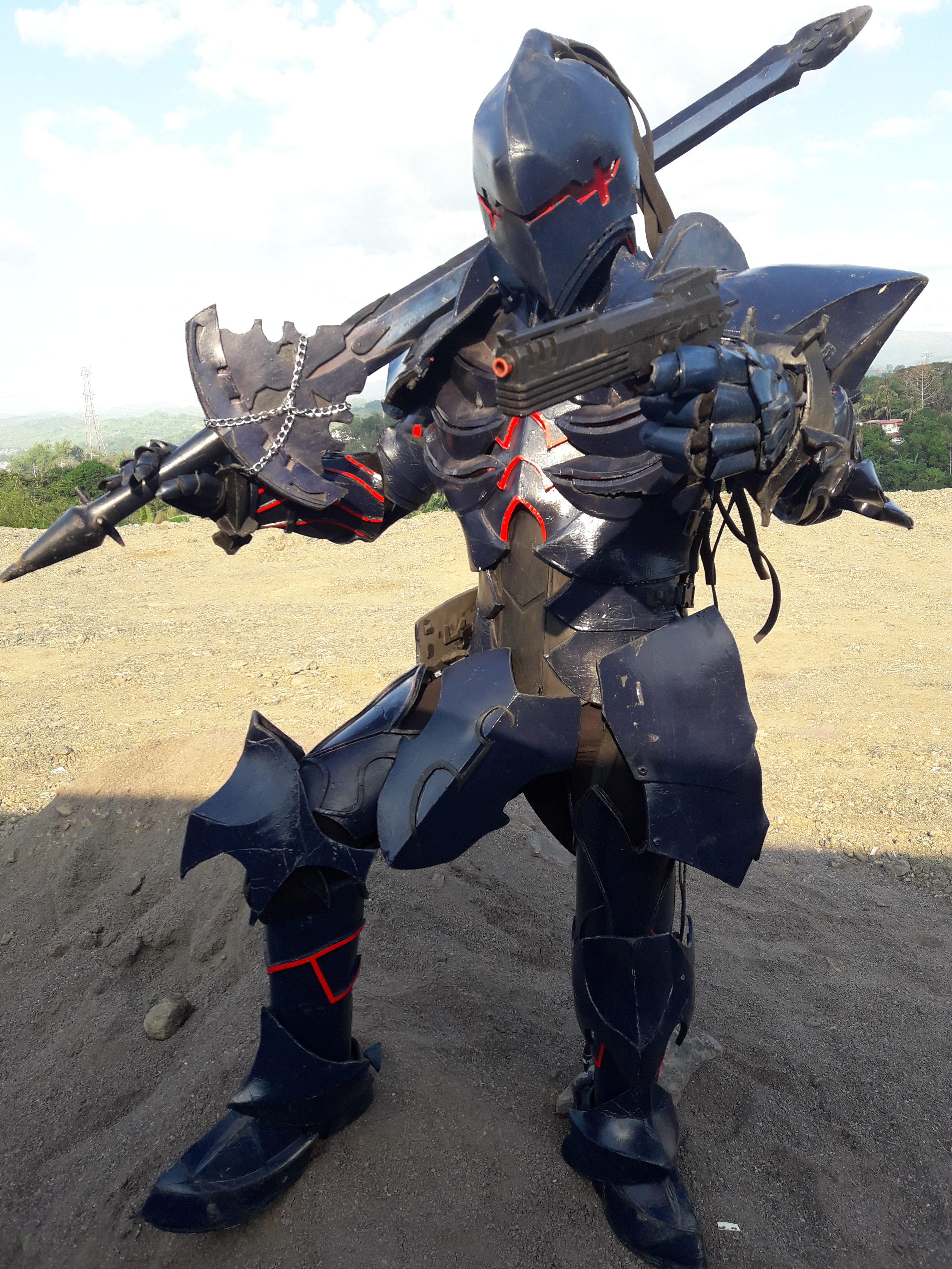 Man in black armor with sword and pistol