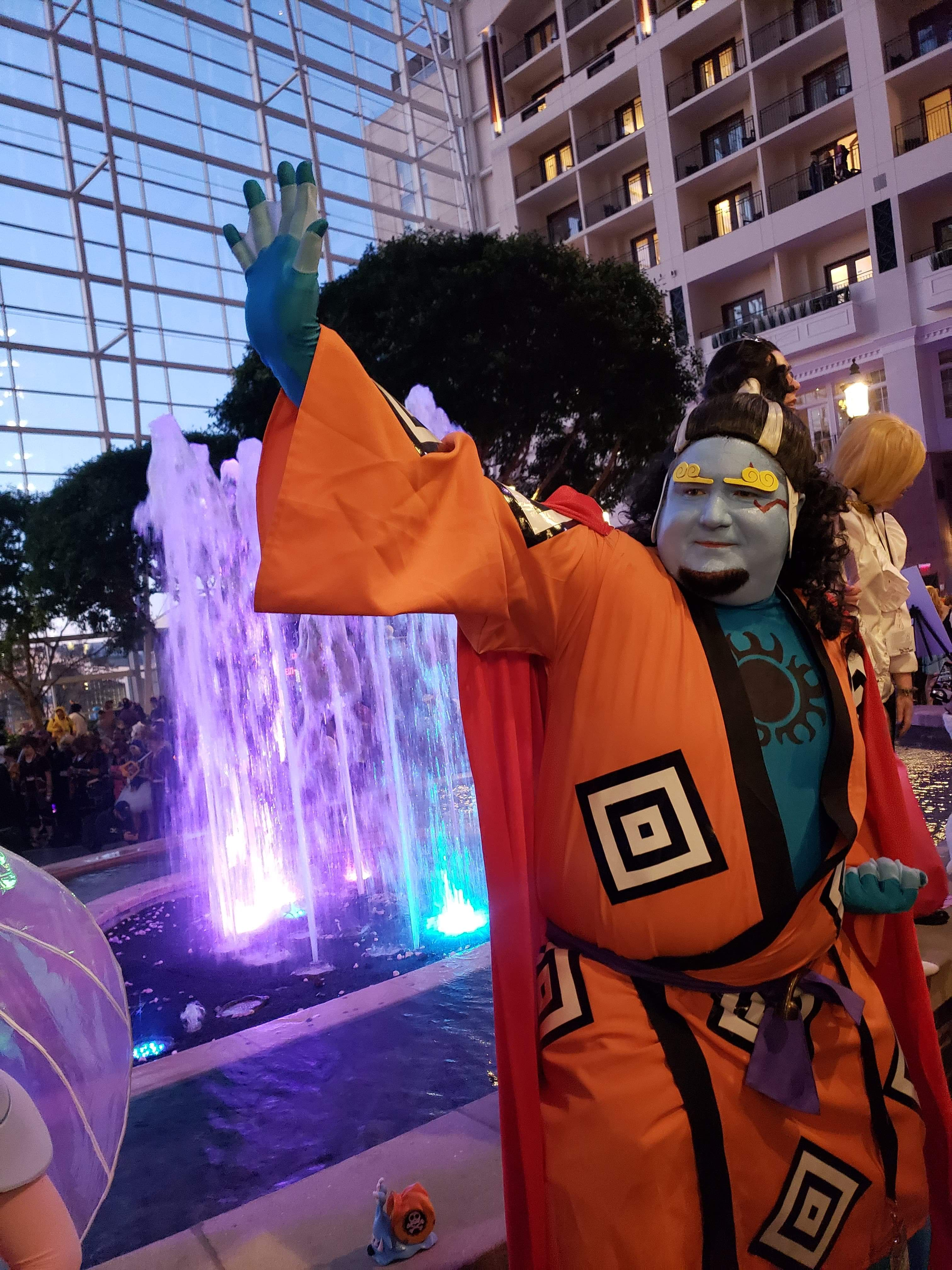 Man with blue skin and orange robes