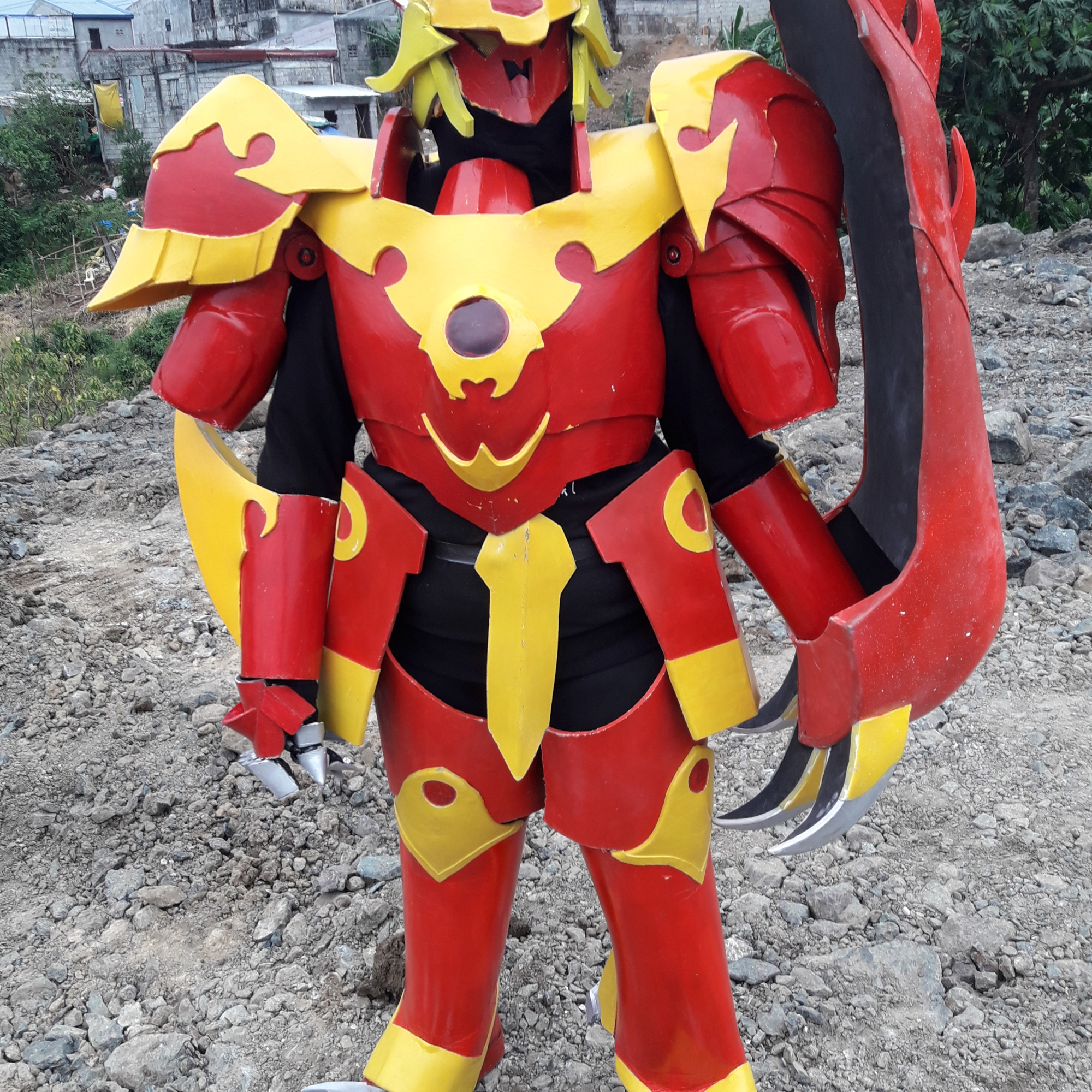 Cosplayer in armor painted in bright, warm colors