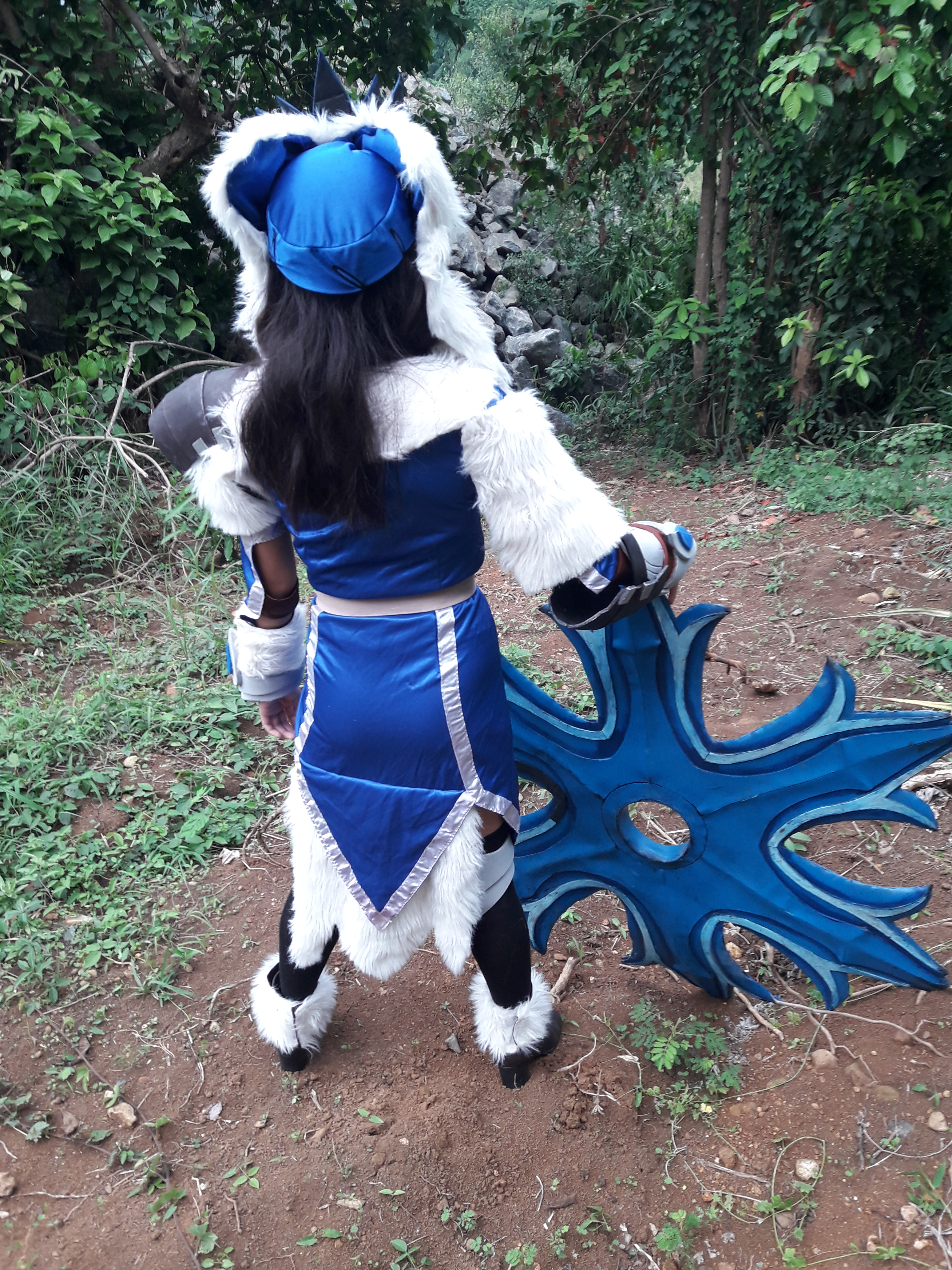 Cosplayer with fancy, furry clothes and a giant shuriken