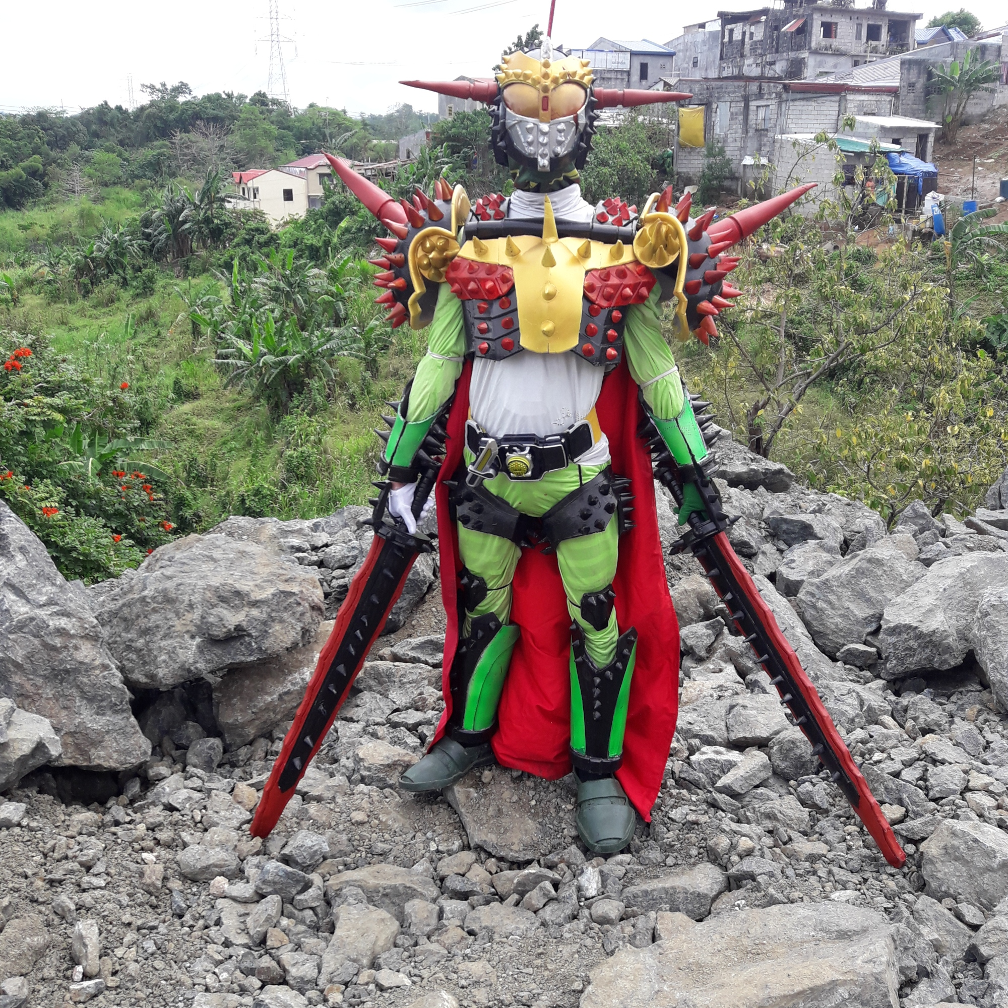 Cosplayer dressed in brightly colored bug-like costume with lots of spikes
