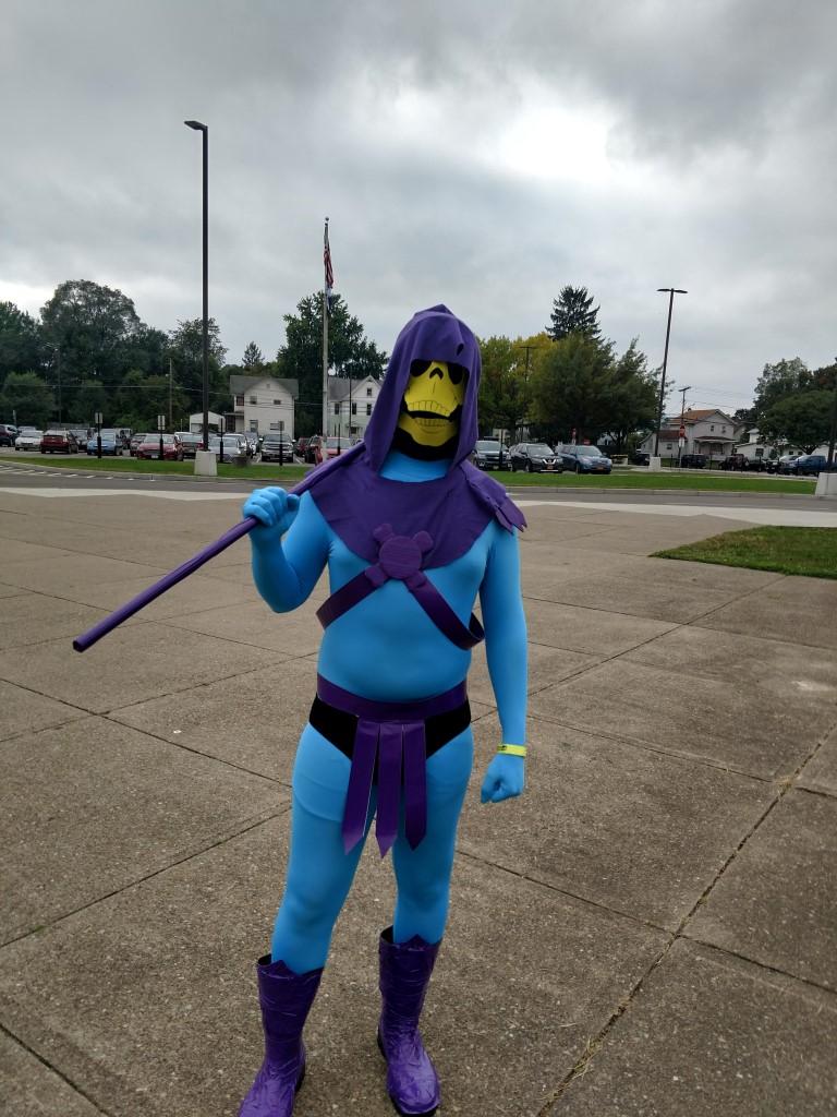 Cosplayer dressed as cartoonish-looking Skeletor