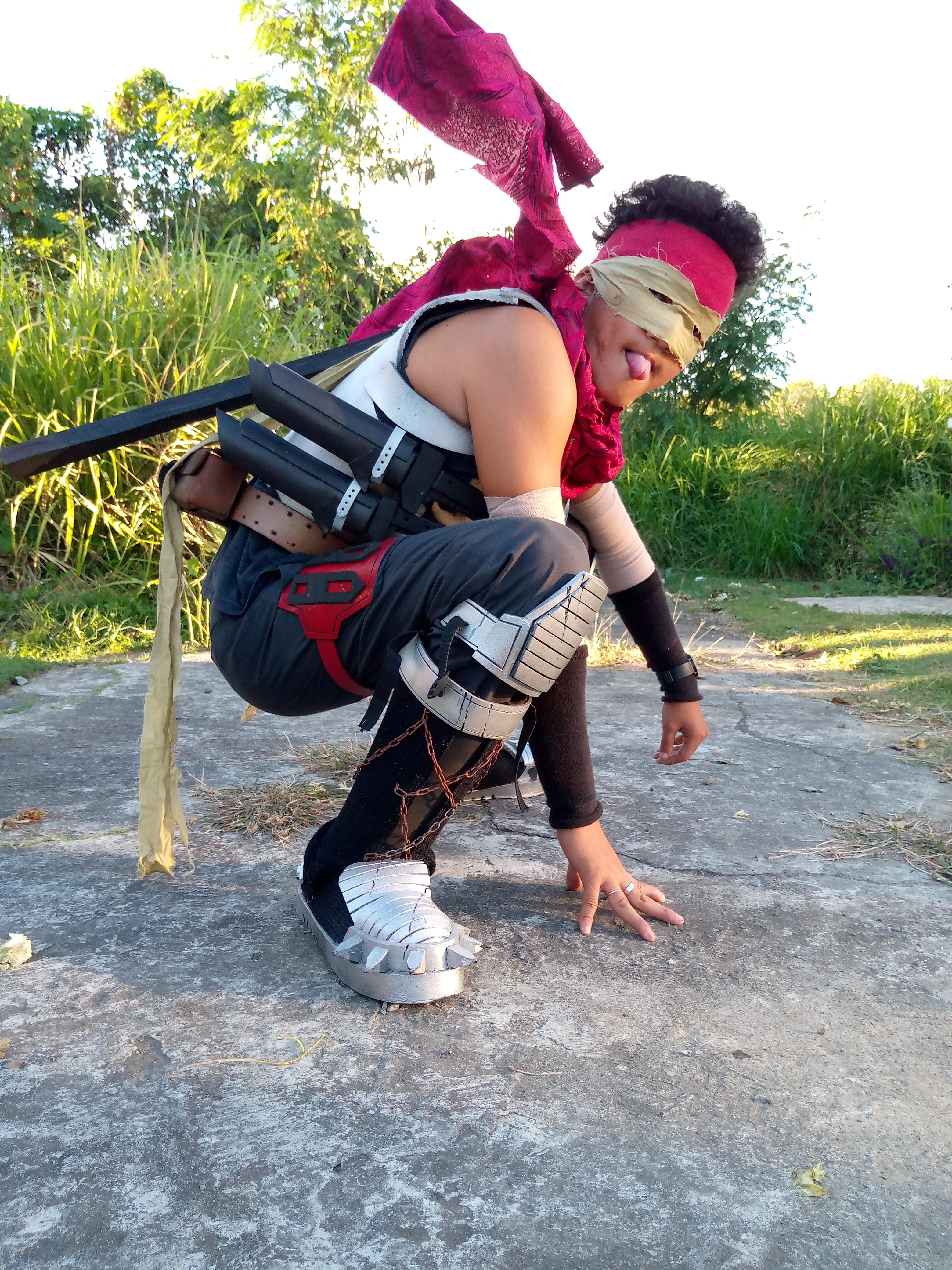 Ninja-looking guy, bent over