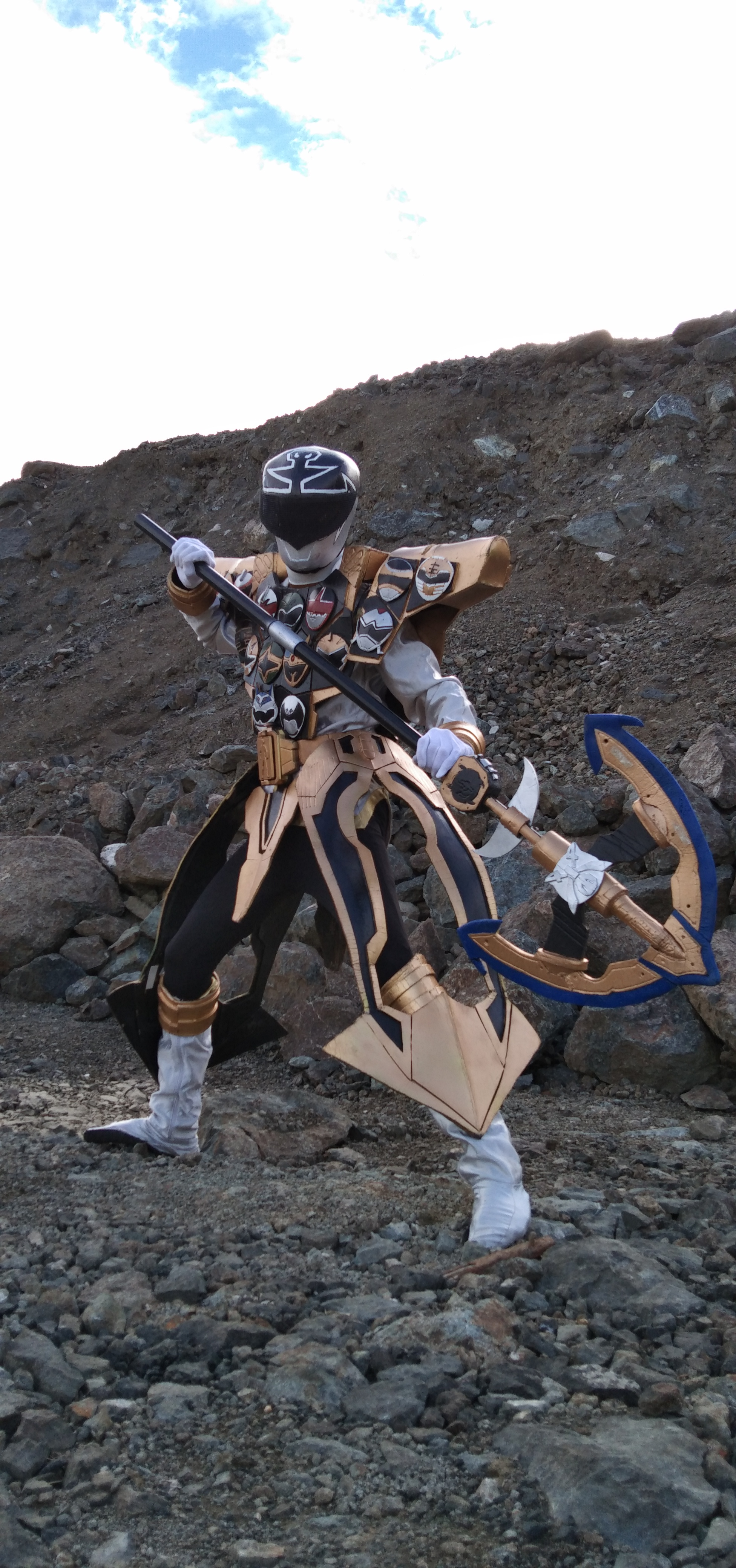 Cosplayer in white and gold, with staff