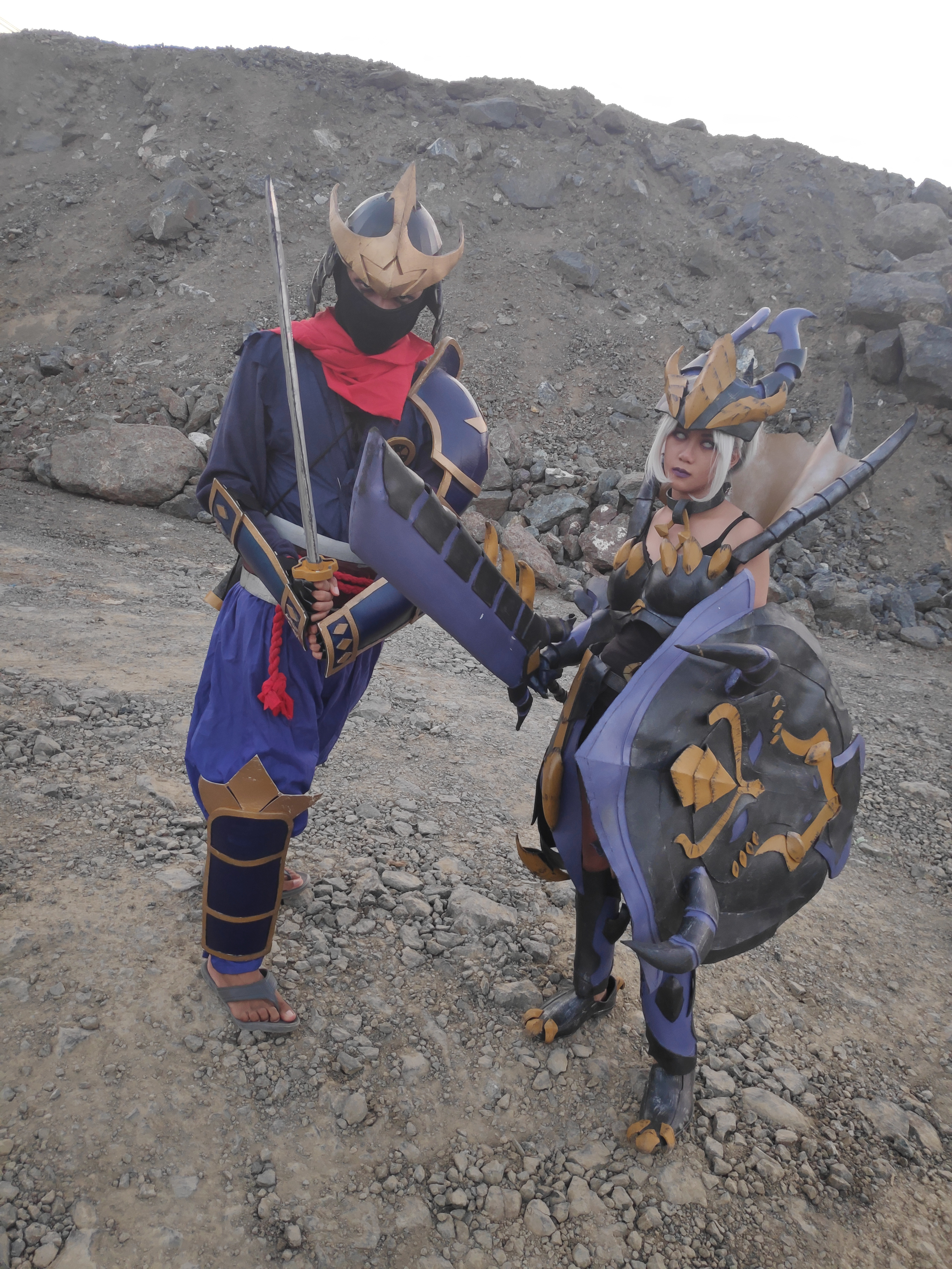 Two armored cosplayers facing the camera