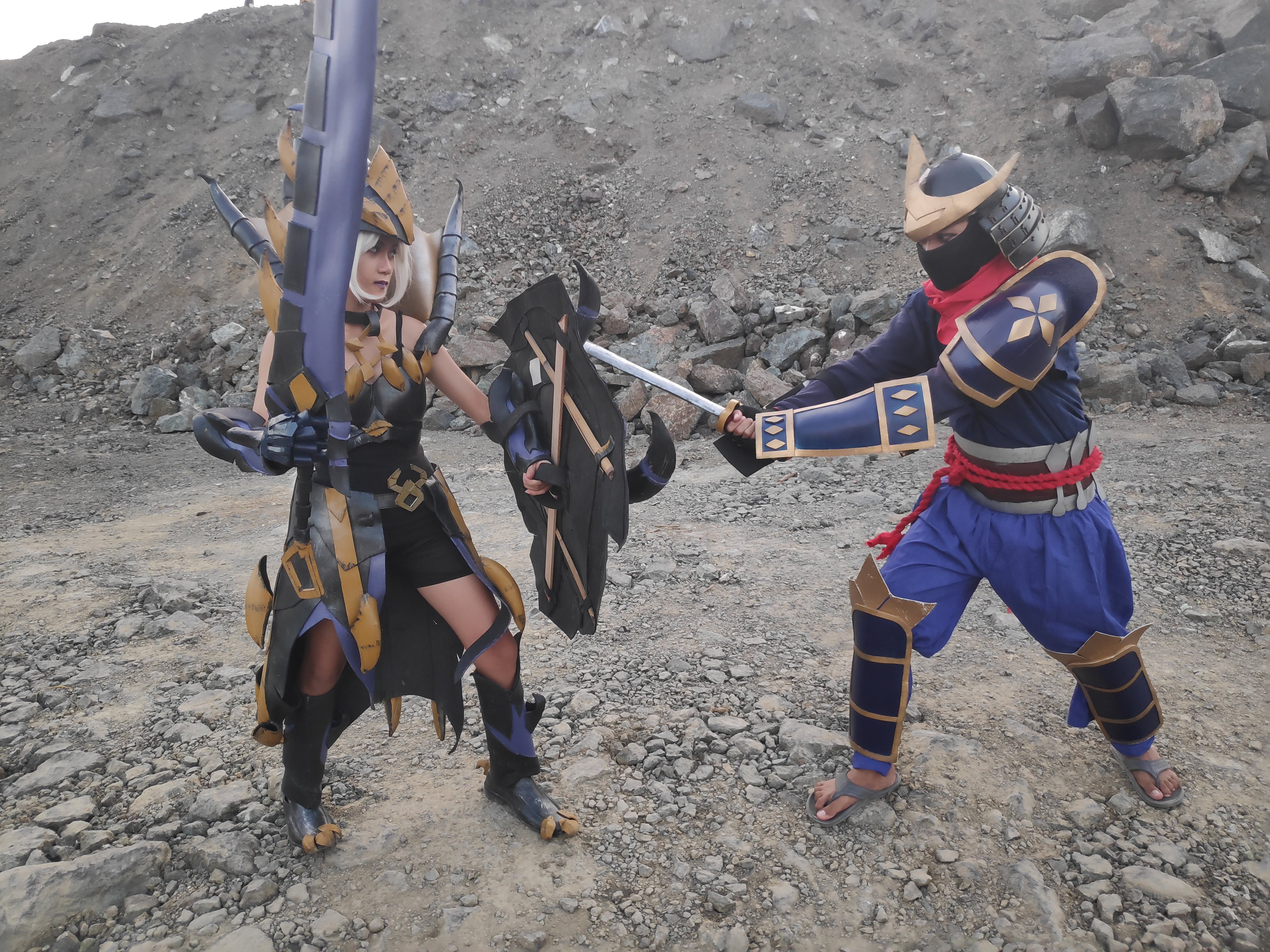 Two armored cosplayers battling