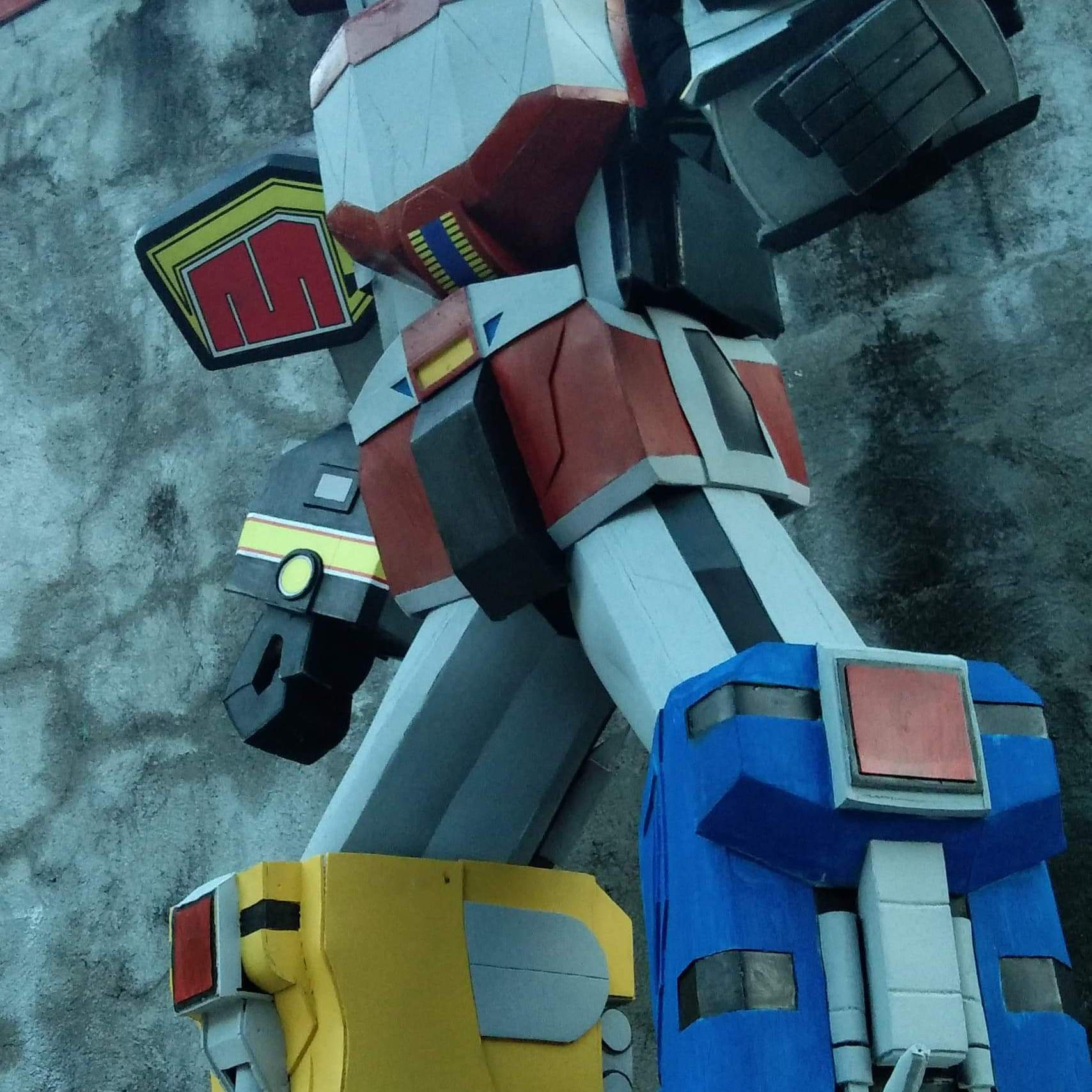 Megazord with brightly colored animal robot parts